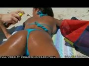 Big Ass Bitch gets an oil massage and a facial at the beach