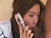 Multitasking asian: watching tv, talking on the phone and having sex