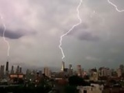Lightning strikes three of the tallest buildings in Chicago at the same tim