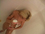 Hot busty blondie teases in the shower