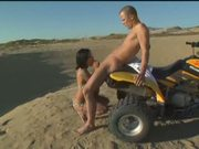 Slutty chick eats dick on the back of a fourwheeler