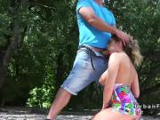 Busty amateur sucks and fucks by the river
