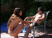 tight body oiled up tanned slut is fucked outside by the pool