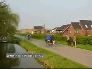 pushing a bike rider into the stream