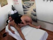 Asian masseuse climbs on top of client