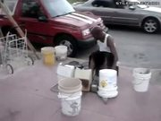Street Drummer Performs On Buckets