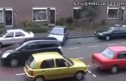 blonde woman trying and failing to park her car