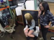 Two babes making out in the back room of a pawn shop