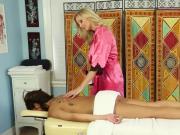 Masseuse caresses client