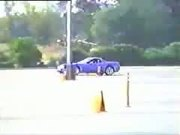 corvette hits two onlookers while going around the track