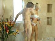 Tattooed blonde MILF massages a lucky stud in bathtub