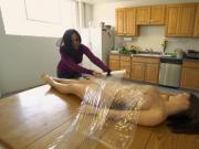 Hot babe convinced to get her body wrapped on the table