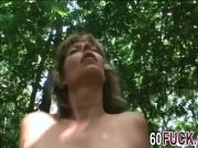 Busty saggy tits blonde fingering mature pussy in the forest