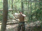 Soldier Bites Chicken's Head Off In The Woods