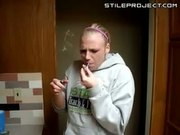 Girl smokes salvia from a pipe