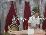 Oiled couple fucks on massage table