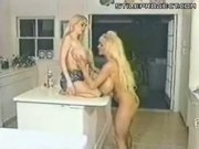 Two Blondes Licking Each Other's Huge Tits In The Kitchen