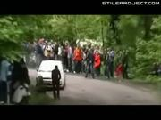 Rally Car Corners Into Bystander