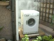 washing machine self destructs - throwing a brick into it