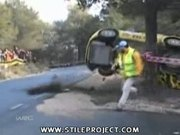 rally car flips and hits a tree