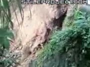 Landslide takes down stuck truck with driver in it. FAIL!