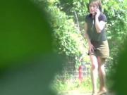 Asian babes piss outdoors