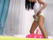 Petite teen babe rolling in her own pee
