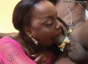 Chubby black bitch jumping on 2 black cocks