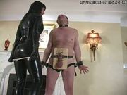 Latex wearing Dom balls abuse