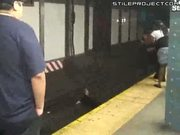 Psycho bitch jumps onto the subway tracks