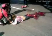 woman run over by truck - turned into minced meat