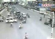 traffic in china - cars run over bikes and motorcycles like crazy