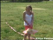 Cute 18yo teen Kitty flying a kite out in a field