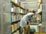 Hot redhead milf flashes and rubs pussy in library