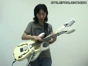 korean kid plays super mario on two guitars at once