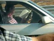Idiot reads a book while driving on the highway