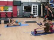 Flexible teens stretching at gym