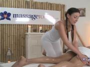 Masseuse gently giving handjob