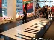 Two girls, one giant piano