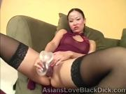 Asian petite trains her little pussy with a huge dildo