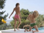 Two tight teen girls touching each others body outdoors
