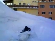 Kid Tackled By Huge Snowball