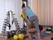 Lesbian fitness coach kissing student