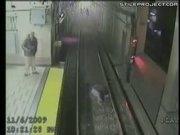crazy bitch jumps onto the subway tracks to kill herself and fails
