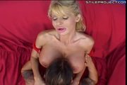INSANELY HUGE TITS on this milf