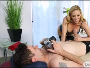 Busty milf posed for the cam then banged on massage table