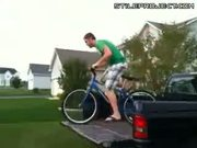Idiot rides his bike off the back of a pickup truck and breaks his neck