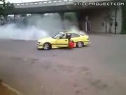 Moron does a burnout and falls out of his car