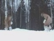 Two naked teens having fun in the snow