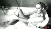 Sexy babe enjoys her bath